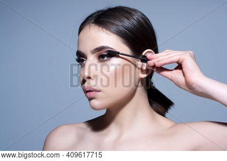 Putting On Black Mascara. Woman Eyelashes. Perfect Makeup. Beauty And Cosmetics
