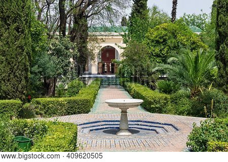 Fez, Morocco - June 02, 2017: The Garden In The Dar Batha. The Former Royal Palace,was Built By The