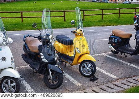 Bergamo, Italy - May 22, 2019: Yellow Popular Italian Scooter Vespa On The Street In Bergamo.