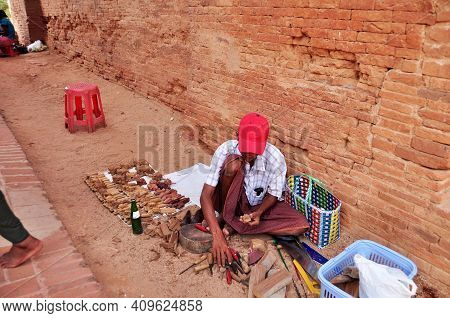 Burmese Men Craftsmanship People Sit On Floor Carving Wooden Toy Souvenir Gift For Sale Travelers In