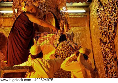 Burma Senior Monk And Burmese Elaborate Ancient Tradition Ritual Of Face Wash And Brush Teeth To Mah