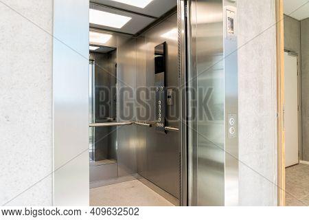 An Elevator On The Third Floor Of An Long Corridor Of An Building