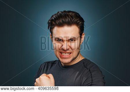 Man emotional studio portrait. Very angry emotions.