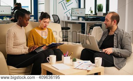 Woman Executive Instructing Diverse Employees In New Modern Company Office Room Before Business Meet