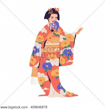 Geisha Standing With Fan In Colorful Kimono. Japanese Woman With Traditional Hairdo Dressed In Natio