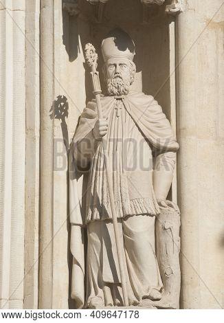 Stone Statue Of A Roman Catholic Bishop At A Church