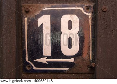 Weathered Grunge Square Metal Enamelled Plate Of Number Of Street Address With Number 18