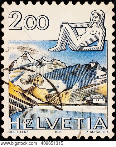 Moscow, Russia - February 21, 2021: Stamp Printed In Switzerland Shows Image Of Virgo - Sign Of Zodi