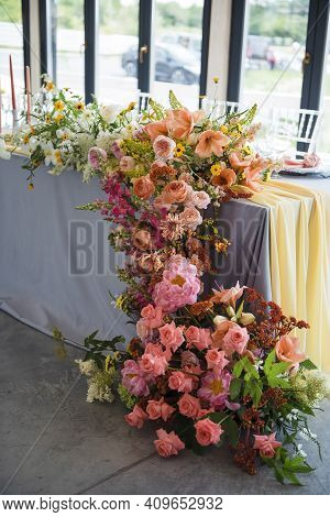 Amazing Composition Of Colorful Flowers On Wedding Table