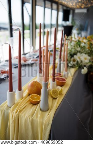 Colorful Candles As Stylish Decoration On Wedding Table