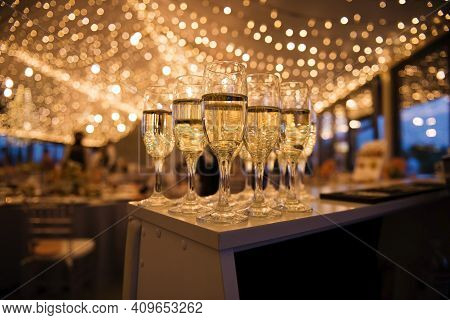 Shiny Glasses Of Cold Champagne At Wedding Party