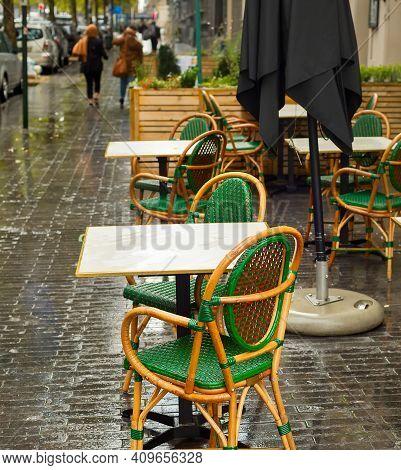 Emty Street Restaurant In The Rainy Day. Brussels, Belgium