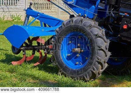 Tractor Cultivator Close Up, New Two-wheeled Tractor With A Cultivator On The Grass