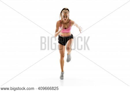 Energy. Caucasian Professional Female Athlete, Runner Training Isolated On White Studio Background.