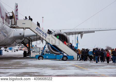 Ukraine, Kyiv - February 12, 2021: Passenger Plane Qatar Airlines A7-alw Airbus A350-900. Winter At