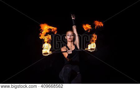 Fire And Sparks. Sexy Woman Twirl Burning Stick In Darkness. Fire Performance. Baton Twirling. Juggl