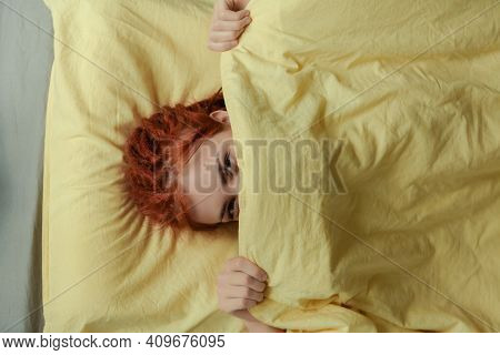 Very Pretty Redhead Girl With Dreads On Bed In Bedroom In The Morning. A Feminine, Gentle Girl. Heal