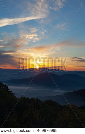 Scenic View Of Mountains Against Sky During Sunrise. Majestic Sunrise Over The Mountains