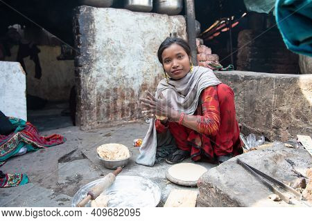 Rajasthan. India. 07-02-2018. A Girl In A Village Of The Rajasthan Is Preparing Lunch For Her Family