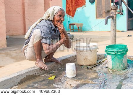 Rajasthan. India. 07-02-2018. An Old Woman In A Village In The Rajasthan Is Enjoying To Refresh Hers