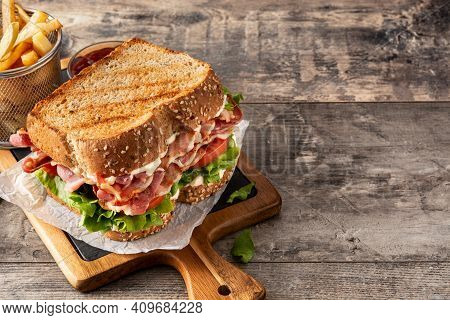 Blt Sandwich With Bacon,lettuce And Tomato On Wooden Table. Copy Space