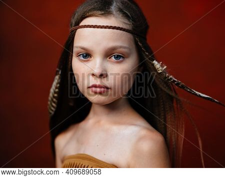 Happy Girl With A Feather In Her Hair Aborigines Indian Tribe Shaman Red Background