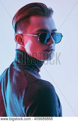 Portrait of a handsome young man in modern sunglasses. Studio portrait. Men's accessories, optics.