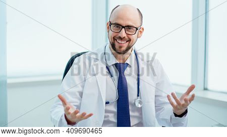 Doctor Conducts A Consultation In His Medical Office.