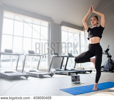 Beautiful Caucasion White Woman Doing Yoga Exercises In Fitness Gym.
