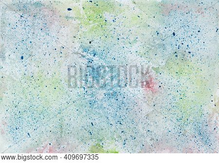Watercolor Wash Background In Blue, Red And Green With Paint Splashes In Blue