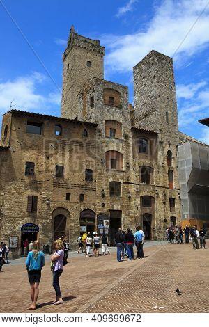 San Gimignano (si), Italy - June 01, 2016: Tower, Cisterna Square, San Gimignano, Tuscany, Italy