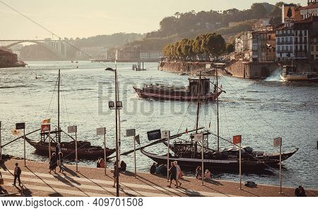 Porto, Portugal: Beautiful City With River Douro And Many Riverboats With Porto Wine Barrels On 19 M