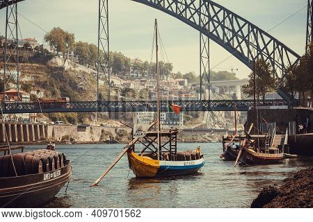 Porto, Portugal: Scenic View On Bridge Over River Douro And Many Riverboats With Porto Wine Barrels