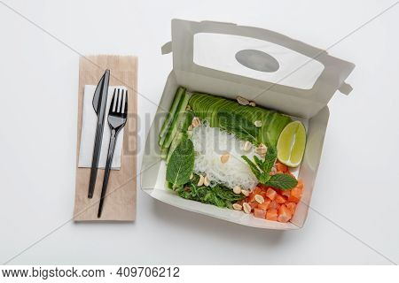 Modern Salad And Useful Food, Delivery And Health Care. Tasty Asian Dish With Fish And Vegetables In