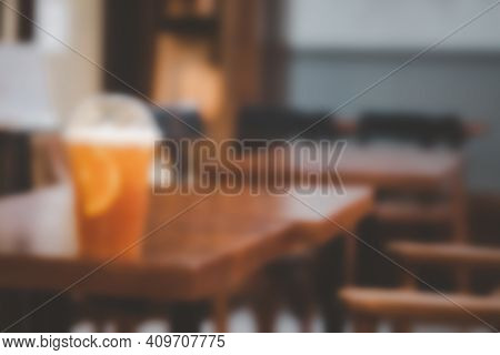 Blur Background Fresh Grapefruit Juice With Ice On Wood Table In Cafe