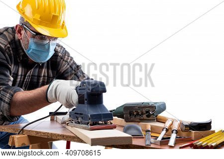 Carpenter Worker At Work Isolated On White Background, Wears Helmet, Goggles, Leather Gloves And Sur
