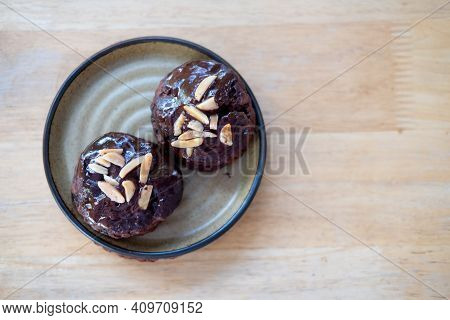 Close Up Of Two Delicious Chocolate Scone On Wood Table