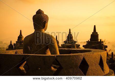 Buddha statue in open stupa in Borobudur or Barabudur temple Jogjakarta Java Indonesia at sunrise. poster