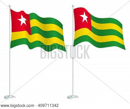 Flag Of Togolese Republic On Flagpole Waving In Wind. Holiday Design Element. Checkpoint For Map Sym