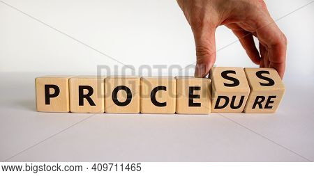 Process Or Procedure Symbol. Businessman Turns Wooden Cubes, Changes A Word 'process' To 'procedure'