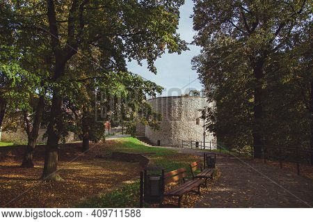 Beautiful Park In The Castle Of The City Of Przemysl On A Sunny Clear Day Against A Bright Sky. Tall