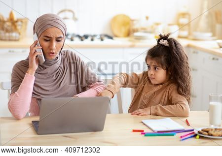 Lonely Little Girl Demanding Attention From Her Busy Muslim Freelancer Mom, Islamic Business Lady Wo