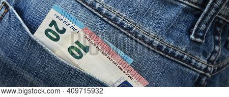 Euro Bill In The Back Pocket Of Jeans. Thirtyeuro In A Denim Pocket.