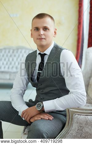 Happy Groom Is Waiting For The Bride. Wedding, Portrait Of A Man Waiting For A Woman