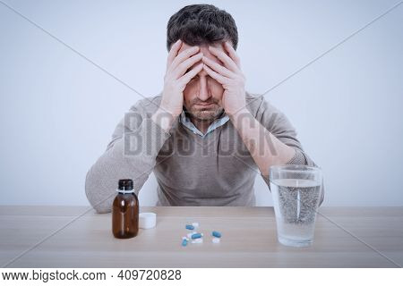 One Man Taking Painkillers To Relieve Pain