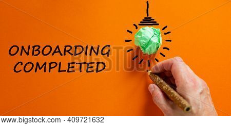 Onboarding Completed Symbol. Businessman Writing Words 'onboarding Completed', Isolated On Beautiful