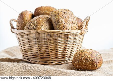 Whole Wheat Bread. Fresh Loaf Of Rustic Traditional Bread With Wheat Grain Ear Or Spike Plant On Lin
