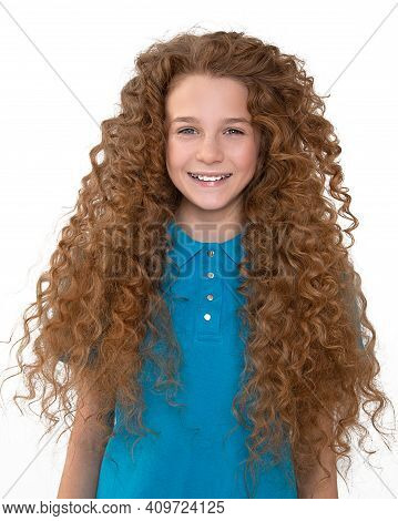 Red-haired Beautiful Teenager Girl With Braces On White Teeth Smiles Broadly Look Into Camera. Denti