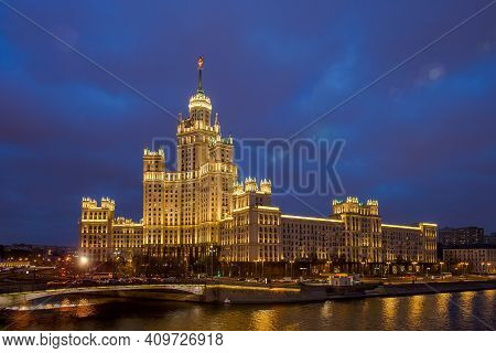 Stalins Skyscraper On Kotelnicheskaya Embankment In The Late Evening, Against The Background Of A Da