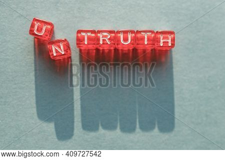 Untruth Is A Word Made Up Of Letters On Cubes, The First Letters Fall Apart